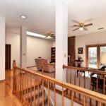 Amazingly Open Concept With Basement Stairs In Middle Of House Photo 602